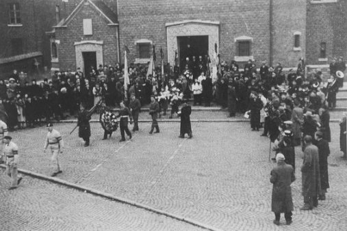Photograph of the Mourners coming out of the Church of St Willibrord, Eisden